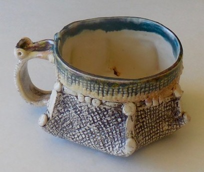 Tea cup, blue rim glaze