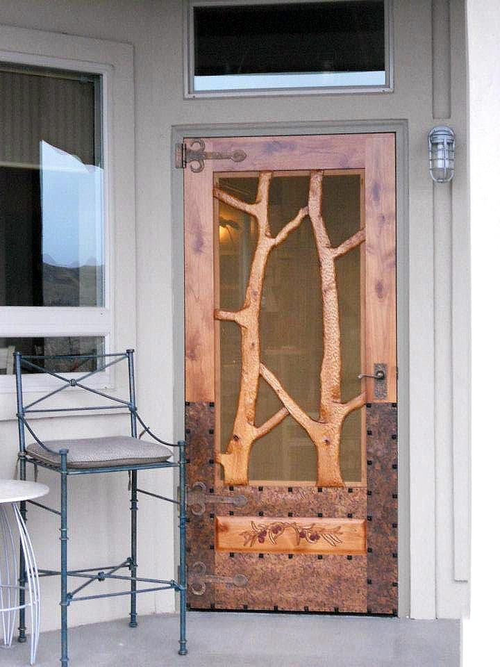 Double sided, hand carved Forest Screen Doors with patina copper overlay as a protect buffer from weather, feet and scratching dogs