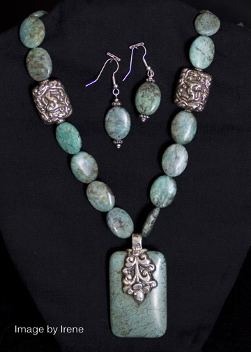 "Turquoise necklace with base metal chain, earrings turquoise with silver plated ear wires – 32"". $99 for the set."