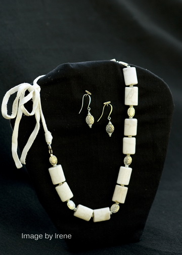 White jasper with base metal beads on white leather, can be tied to various lengths, matching base metal earrings on silver plated ear wires.  $35 for the set.