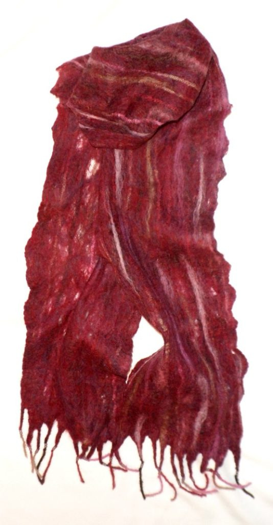 "Cranberry Merino wool with Wool yarns running through cobweb base and making fringe. 7"" x 76""  $50"