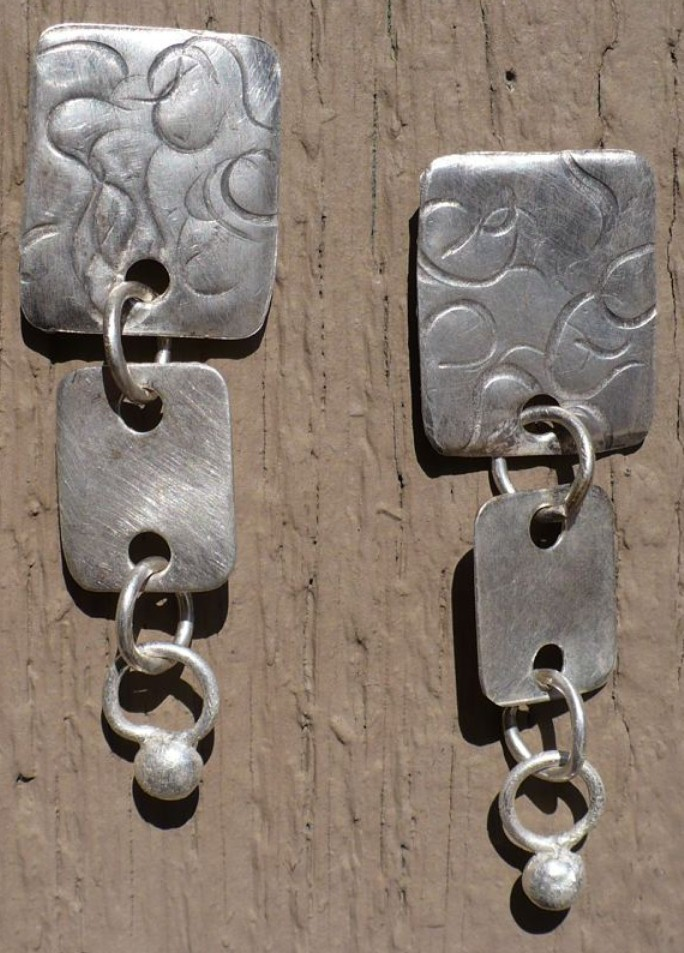 "Sterling Silver Swirls - The texture of these post back earrings swirl with grace and graduating rectangles down to a silver nugget.  Length is 2"" total."