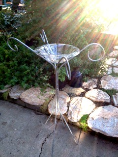 Upcycled pieces turned into a Bird Bath.