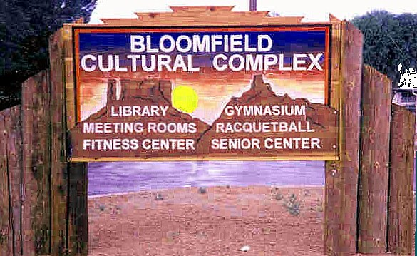 Cultural Complex sandblasted Redwood sign.