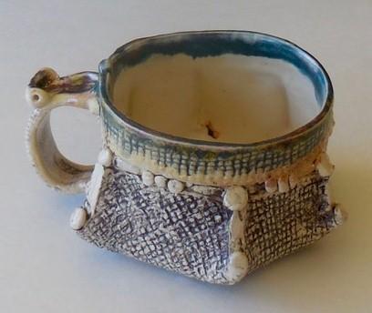 Tea cup, blue rim glaze