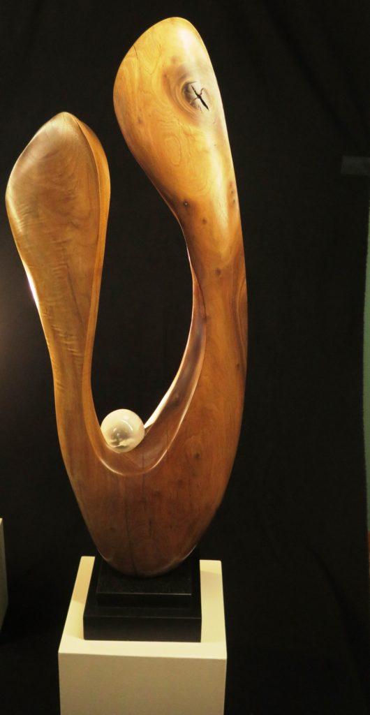 Symmetry, 40x14x6, Black Walnut on marble base.