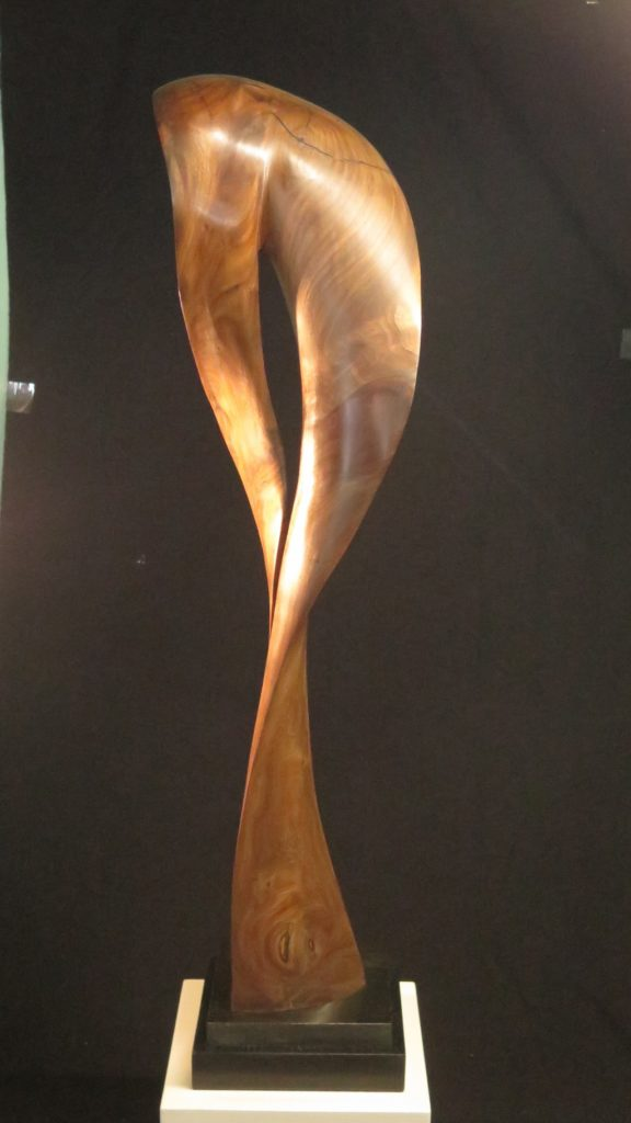 Symmetry Without Dimensions #3, 42x14x7. Black Walnut on marble base.
