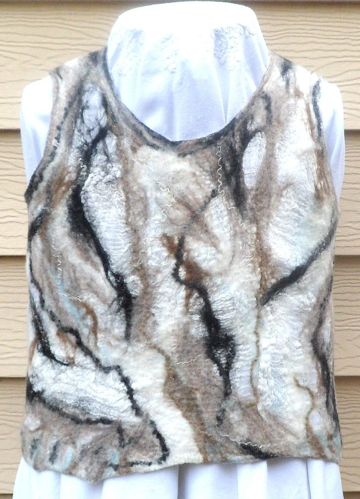 Reversible sleeveless top made from Merino wool on a cotton gauze base.