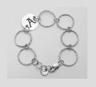 """Link Together - Sterling rings approximately 1"""" inside diameter, each made individually and highlighted with a sterling coin. This linked bracelet is 7 ½"""" long and coin stamped with letter/words/dates, etc."""