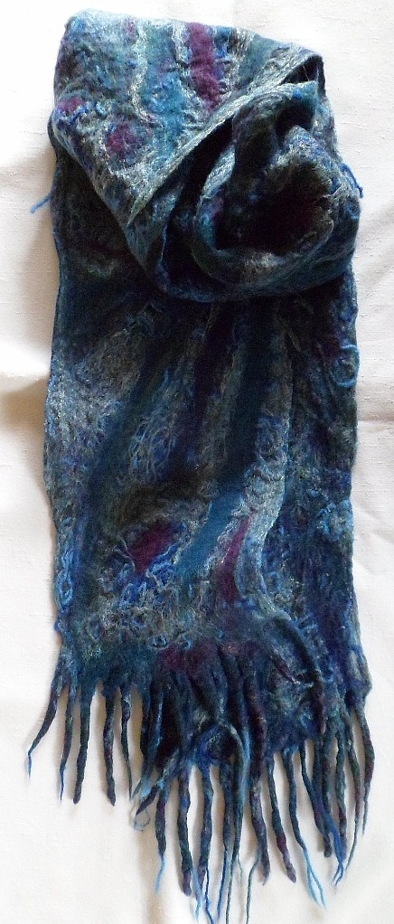 """Merino wool with wool and silk yarns woven throughout. 8"""" x 80""""  $50"""