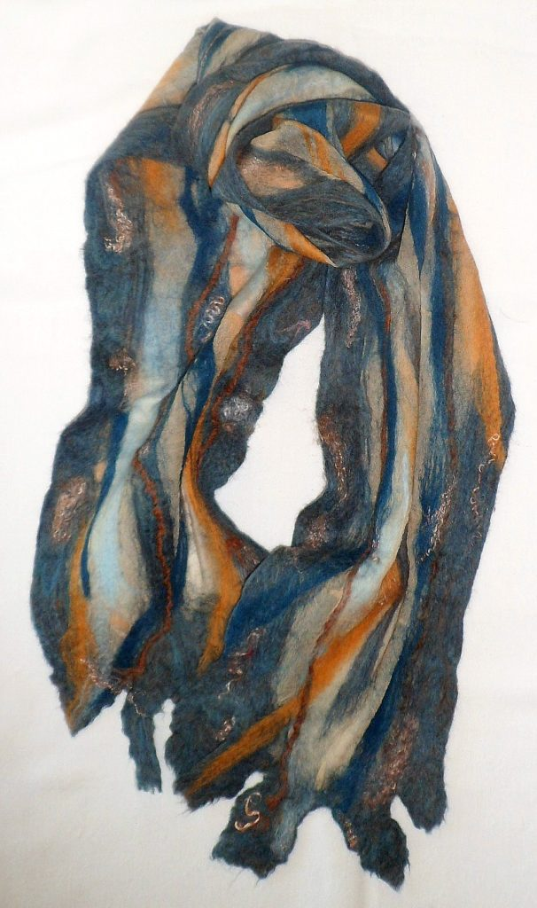 """Denim blue and gold Merino wool on an eco dyed silk panel.  9"""" x 80""""  $55"""