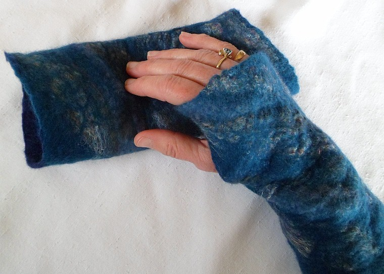 Fingerless mittens let your fingers be free and your hands nice and cozy. $25 /pair
