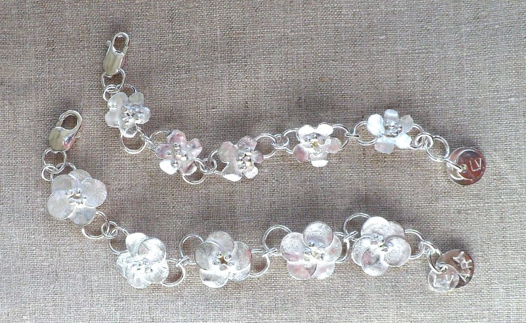 BLOSSOM BRACELET, made for over 20 years. You'll see them all around Yakima and Washington state.