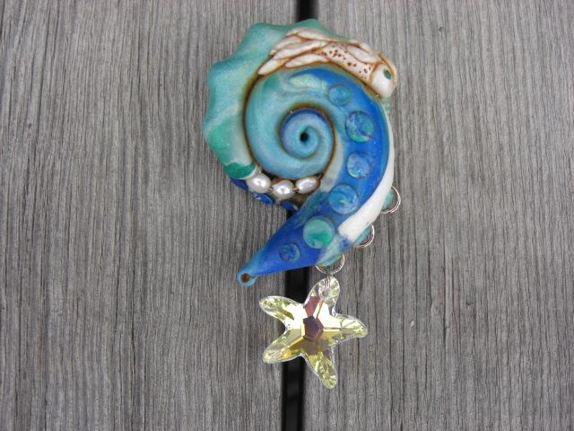 Swimming Solo - A polymer clay brooch embelished with fresh water pearls and a swarovski starfish.