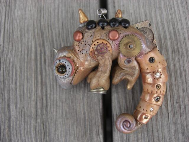 Karma is a steampunk chameleon polymer clay pin