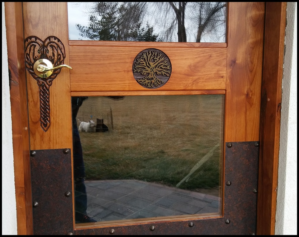 Hand carved Celtic horse heads and a sandblasted image of an early Tree of Life drawing. Door made of quality kiln dried Alder Wood and sealed with Teak oil and polyurethane.