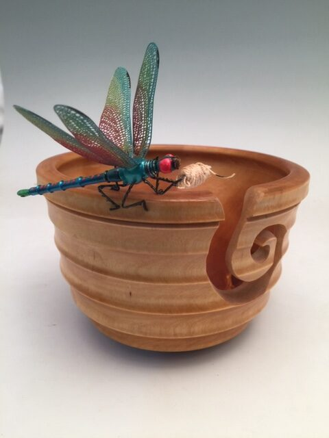 """""""The Dragonfly Yarn Bowl"""" This ~9X9X6"""" maple, lathe-turned bowl with its inverted 'J' thread cut-out is ideal for average-sized knitting Projects. I make the DragonLady out of aluminum And steel and epoxy clay and wire, then paint it in Acrylics and lacquer it in a satin sheen. The bowl Is clear-coated in Polyurethane for durability, Functionality, cleanability, and it's food safe. Signed by jsbarany@aol.com 5099495873 $175"""