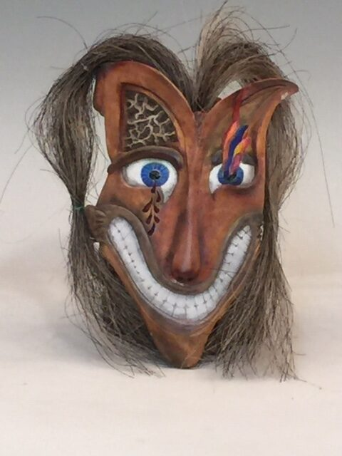 """""""Wiley Coyote"""" He's wild and conniving, he's got bloody tears coming out of One eye and flames shooting out of the other. A wicked and Toothy smile completes his picture of someone you Just can't trust. Watch Out! Birch, 6X9X3"""", hand carved mask on a rotating wall mount that Can position him instantaneously to be looking at anyone in His room. Clearcoated in polycoat which allows easy cleaning. Signed by jsbarany jsbarany@aol.com 5099495873 $190"""