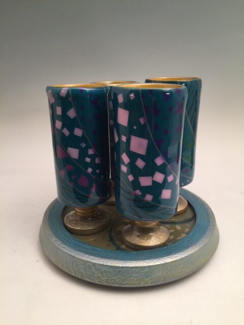 """""""The Blue Tumblers 4"""" A set of tall tumblers and a basal stand. ~8X8X9"""". Acrylic paints and Designs adorn the vessels and they are All coated with a thick film of epoxy that Is food safe and they are meant to be Used every day. They can be warm wet Washrag cleaned but don't dump them In sinkwater, microwave or dishwasher And they'll last forever. Time for drinks? Signed by jsbarany jsbarany@aol.com 5099495873 $350"""