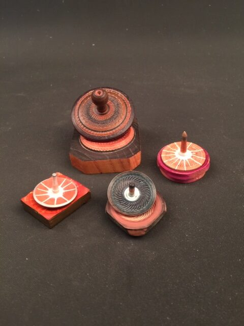 """""""The Little Tiny Tops"""" Each is ~2X2"""" and each has a little platter to Sit on. They are lathe-turned, textured, And painted in acrylics, finished in lacquer To a satin sheen. And they all spin great. By jsbarany@aol.com 5099495873 $15 ea"""