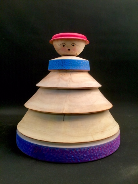 """""""Garden's Lady"""" At ~ 8X8X9"""", this lady is wearing her gardening outfit and Is made hollow so she can sit on a garden post without Getting nudged over by the dog or blown over by the wind. Lathe-turned in maple, she is painted in acrylics and then Over-coated in exterior oil-urethane with a UV stabilizer Meant to tolerate the South Dakota midday sun. Signed by jsbarany@aol.com 5099495873 $50"""